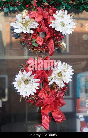 A Christmas Wreath on a window - Stock Photo