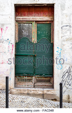 Closed old wood door painted fade green - Stock Photo