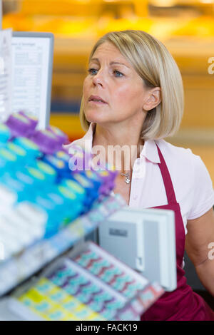 Cashier in the supermarket - Stock Photo