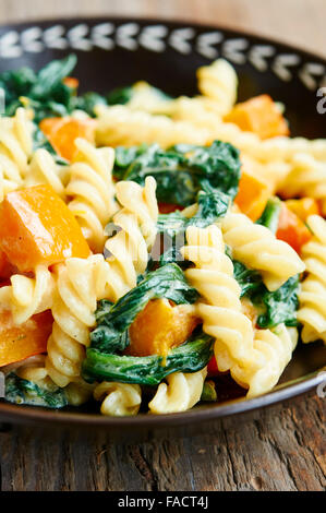 Bowl of pasta with squash and spinach - Stock Photo