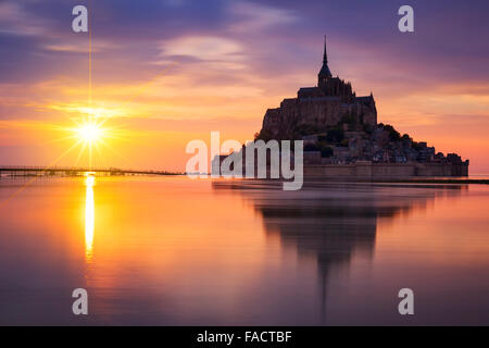 View of famous Mont-Saint-Michel at sunset, France. - Stock Photo