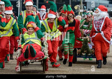 Santa Fun Run and Wacky Sleigh Race. Hastings. East Sussex. England. UK - Stock Photo