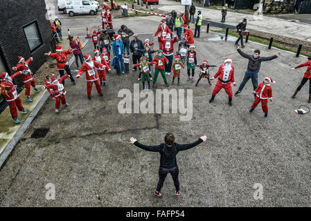 Warming up before the St Michael's Hospice. Santa Fun Run and Wacky Sleigh Race. Hastings 2015 - Stock Photo