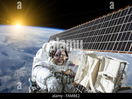 Astronaut in outer space on the space station- elements of this image furnished by NASA - Stock Photo