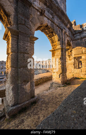 Architecture Details of the Roman Amphitheater Arena in Sunny Summer Evening. Famous Travel Destination in Pula, - Stock Photo