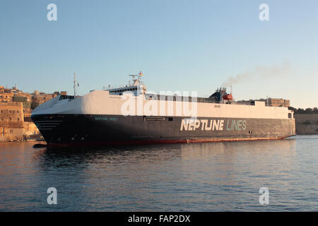The Neptune Lines ro-ro vehicles carrier Neptune Aegli entering Malta's Grand Harbour at dawn. Worldwide transport - Stock Photo