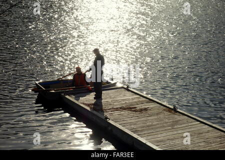 Two men talking at a dock in Ontario - Stock Photo