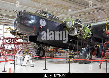 An Avro Lancaster bomber inside the Canadian Warplane Heritage Museum in Hamilton Ontario. Undergoing winter maintenance. - Stock Photo