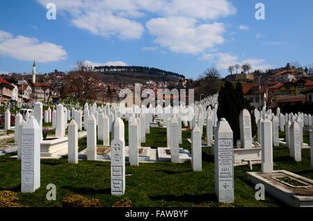 Islamic Muslim Tombstones of Bosnian soldiers at Martyrs Memorial Cemetery Sarajevo Bosnia - Stock Photo