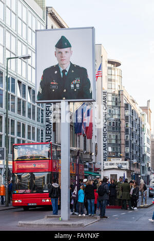 BERLIN, GERMANY - OCTOBER 31, 2015 : Tourists visiting Checkpoint Charlie in Berlin, Germany. - Stock Photo