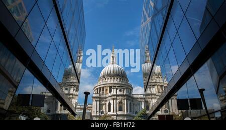 View of St Pauls Cathedral between glass fronted office buildings, London, UK - Stock Photo