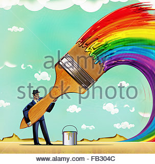 Businessman with large paintbrush painting multicolored rainbow - Stock Photo
