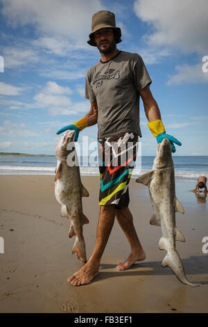 Fisherman with cazon, dogfish, Punta del Diablo. Uruguay - Stock Photo