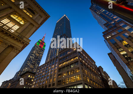 The Empire State Building illuminated with Christmas lights at twilight. Skyscrapers on 5th Avenue, Midtown Manhattan, - Stock Photo