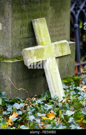 Stone cross on a cemetery Bonn Germany Europe - Stock Photo