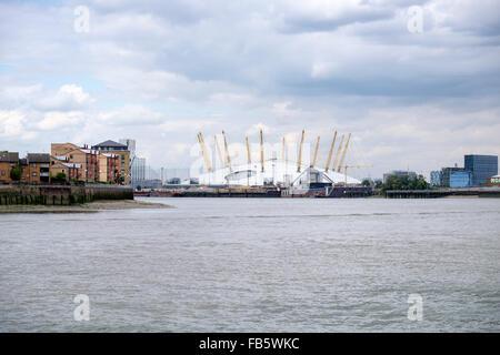 Millennium Dome (the O2 Arena) on the Greenwich peninsula, UK, seen from the River Thames - Stock Photo
