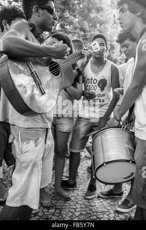 RIO DE JANEIRO, BRAZIL - FEBRUARY 28, 2014: Young Brazilian musicians make music at the gathering of the Banda de - Stock Photo