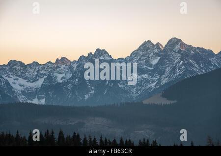 Landscape of Tatra Mountains at sunset on the Slovak-Polish border - Stock Photo