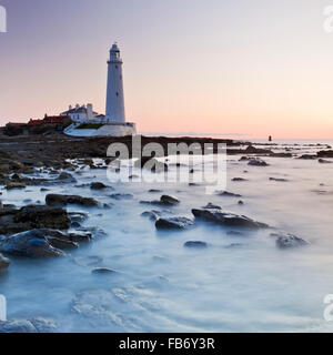 St. Mary's Lighthouse on the Northumbrian coast near the town of Whitley Bay, England. The lighthouse was completed - Stock Photo