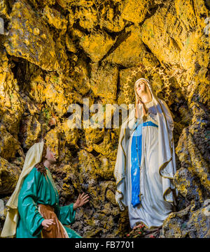 Representation of the apparitions of the Blessed Virgin Mary in the grotto at Lourdes - Stock Photo