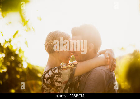 Italy, Tuscany, Portrait of mature couple embracing - Stock Photo
