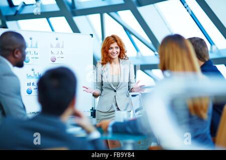 Business people having board meeting in modern office - Stock Photo