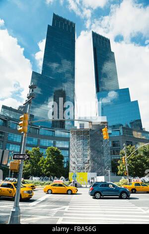 USA, New York City, Manhattan, View along zebra crossing leading towards two skyscrapers - Stock Photo