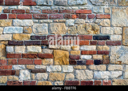 Brick and cotswold stone wall texture pattern - Stock Photo