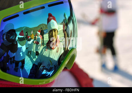 (160115) -- HOLONBUYR, Jan. 15, 2016 (Xinhua) -- Teenagers are reflected in the sunglasses during a winter sports - Stock Photo