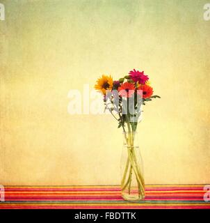 Gerberas In Vase On Table Against Wall - Stock Photo
