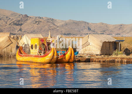 Reed boat on Island of Uros. Those are floating islands on lake Titicaca located between Peru and Bolivia. Colorful - Stock Photo