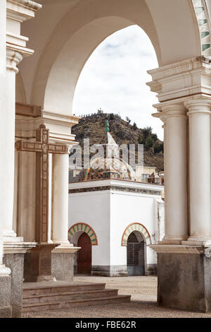 View through archway onto a small chapel on the courtyard of the Basilica of Our Lady of Copacabana in the small - Stock Photo