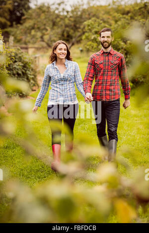 Farmer couple holding hands - Stock Photo
