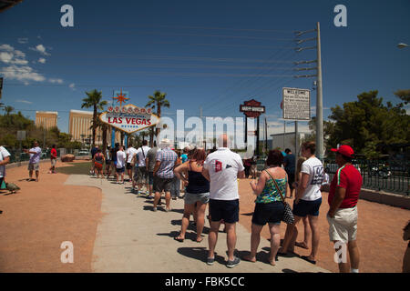 Queue of tourists waiting to take their pictures at the 'Welcome to Las Vegas' Sign. - Stock Photo