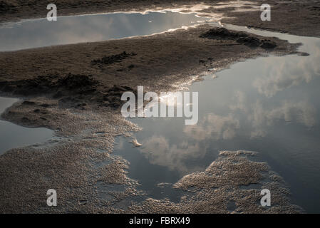Clouds reflected in the Brahmaputra River as the sun goes down from Majuli Island, Assam, India. - Stock Photo
