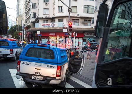 Police cars blocking the road, Copacabana, Rio de Janeiro, Brazil - Stock Photo