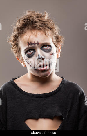 Screaming walking dead zombie child boy - Stock Photo