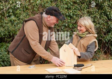 Nest box, birdhouse, building a nesting box, grandpa and grandchild, Nistkasten, Meisenkasten, Vogelnistkasten, - Stock Photo