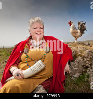 Asa Priest in traditional viking clothing, holding a bull horn. Asa beliefs also know as Paganism. - Stock Photo