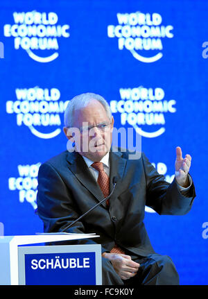 Davos, Switzerland. 21st Jan, 2016. German Minister of Finance Wolfgang Schaeuble addresses the audience at an annual - Stock Photo