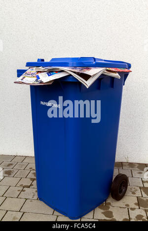 Blue waste paper recycling bin - Stock Photo