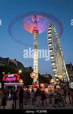 'Air Swing' and Ferris wheel, Tuileries Garden, Paris, France - Stock Photo
