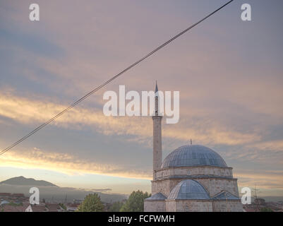 Mosque and electrical wire at sunset in Prizren, Kosovo, Albania. - Stock Photo