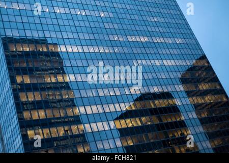 Bruxelles - reflections on office building at dusk - Stock Photo