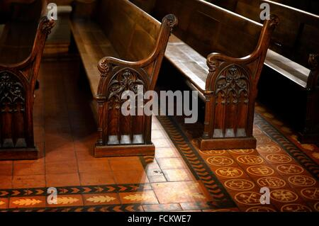 Europe, Switzerland, Geneva, Cathedral Saint-Pierre, interior detail, rows of wooden pews for worship - Stock Photo