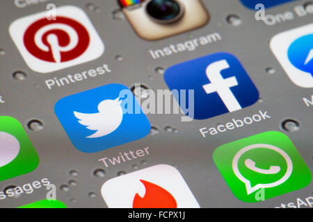 Social media icons, including twitter and facebook apps on an iphone 6 screen - Stock Photo