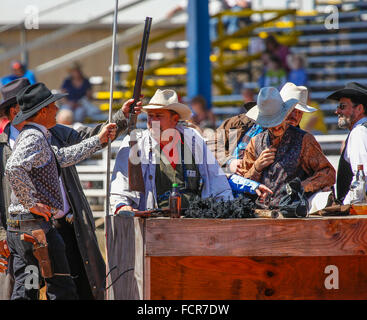 Cowboy re-enactment shootout at Arcadia All-Florida Championship P.R.C.A. Rodeo held in the southwestern Florida - Stock Photo