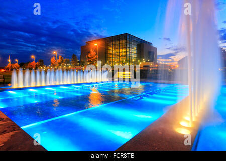 New national library in Zagreb by night with illuminated fountain in front. - Stock Photo