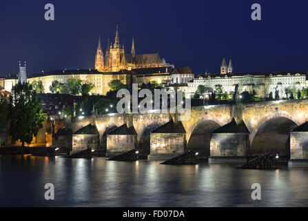 Vltava river, Charles Bridge and St. Vitus Cathedral at night against a dark blue sky. Karluv Most, Prazsky hrad. - Stock Photo