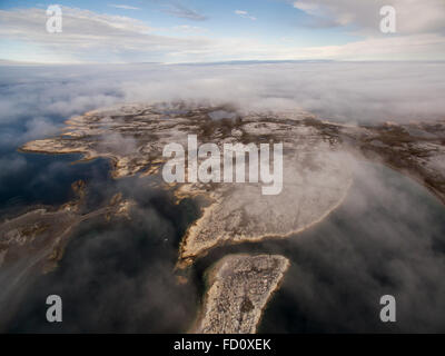 Canada, Nunavut Territory, Rankin Inlet, Aerial view of fog-covered Marble Island along western shore of Hudson - Stock Photo